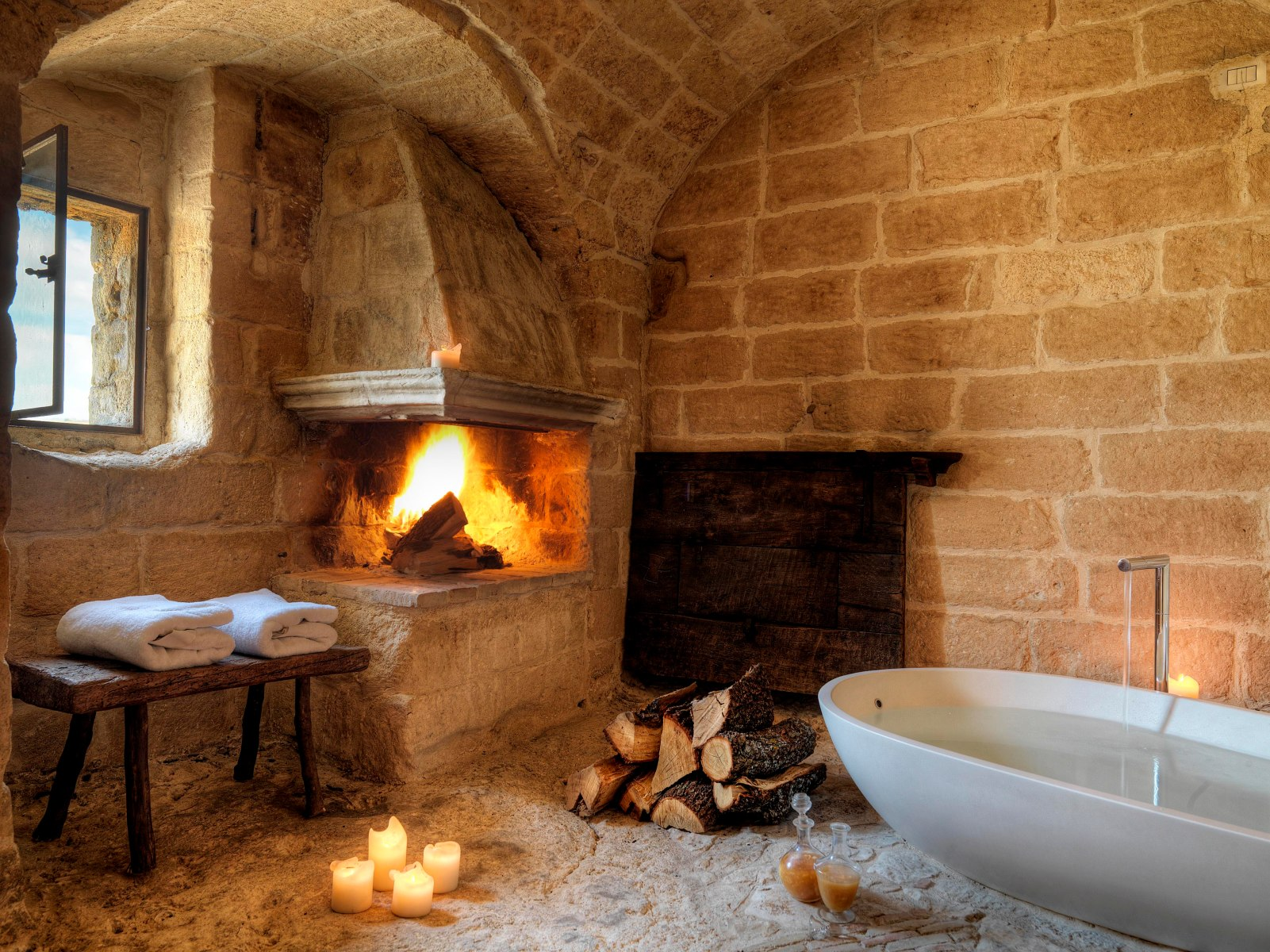 Cave 13's romantic bathtub and fireplace. Perfect Italian accommodations.